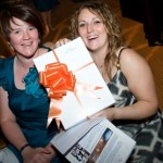 CAFT fundraiser Jenny O'Hare presents Caroline Fielding with her auction prize